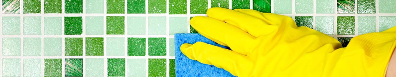 image of custodian scrubbing bathroom tiles
